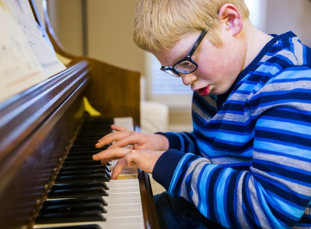 "Ben Schneider, 11, plays Ben Folds' ""Sky High"" on piano in his home on Tuesday, April 12, 2016 in Frisco. Schneider is autistic, has impaired vision and has cerebral palsy.  He will have the chance to meet his favorite musician, Ben Folds, on Thursday when he performs at The Majestic. (Ashley Landis/The Dallas Morning News)"