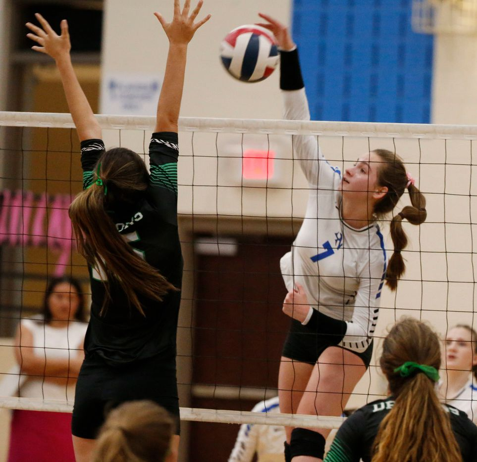 Byron Nelson's Paige Flickinger (7) tries to get the ball past Southlake Carroll's Delaney Bell (15) during a match last season. Byron Nelson and Carroll will play in separate Gold Bracket quarterfinals Saturday at the Northwest ISD Volleyball Classic. (Michael Ainsworth/Special Contributor)