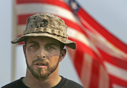 Marine Corps veteran Adam Kokesh talks with reporters during a news conference in Washington on June 1, 2007.