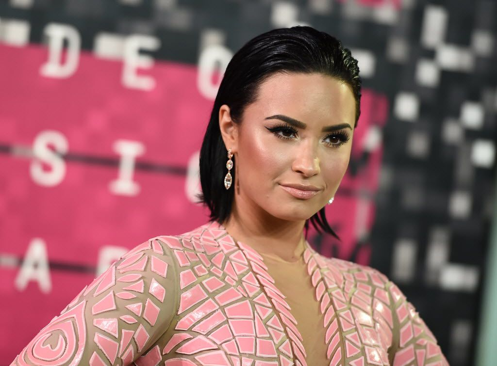 Demi Lovato arrives at the MTV Video Music Awards at the Microsoft Theater on Sunday, Aug. 30, 2015, in Los Angeles.