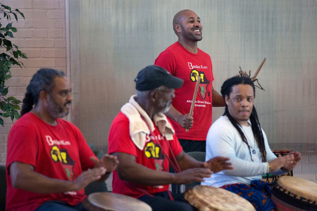 Tony Browne (standing), director of Bandan Koro African Drum and Dance Ensemble, rehearses with his fellow drummers at Sammons Center for the Arts. They perform as part of the Elevator Project this month.