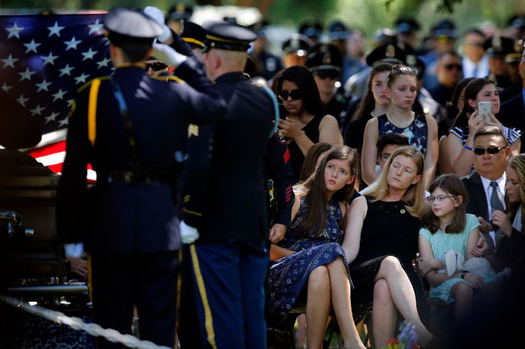 Heidi Smith and her daughters Victoria and Caroline were graveside as they laid her husband Dallas police Sgt. Michael Smith to rest at the Restland Funeral Home and Cemetery in Dallas, Thursday, July 14, 2016. Smith was gunned down in an ambush attack in downtown Dallas a week ago. Four Dallas police officers and one DART officer were killed. (Tom Fox/The Dallas Morning News)