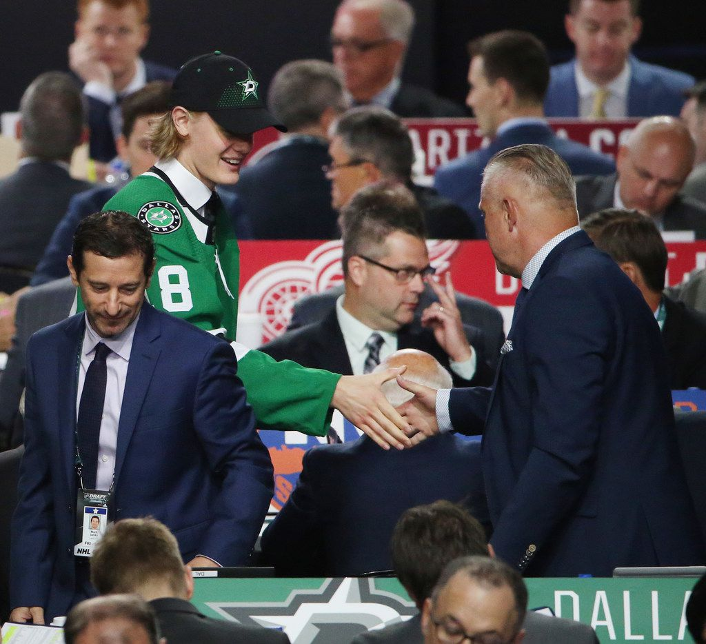 Albin Eriksson greets Dallas Stars officials after being selected with the 44th pick from the SHL during day two of the National Hockey League Draft at the American Airlines Center in Dallas Saturday June 23, 2018. (Andy Jacobsohn/The Dallas Morning News)