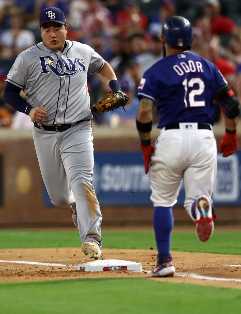 ARLINGTON, TEXAS - SEPTEMBER 10:  Ji-Man Choi #26 of the Tampa Bay Rays makes the out against Rougned Odor #12 of the Texas Rangers in the second inning at Globe Life Park in Arlington on September 10, 2019 in Arlington, Texas. (Photo by Ronald Martinez/Getty Images)