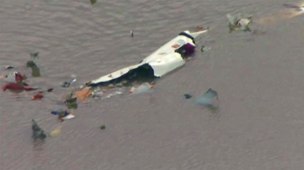 This image taken from video provided by KRIV-TV (FOX 26) shows the wreckage of a cargo plane in Trinity Bay.