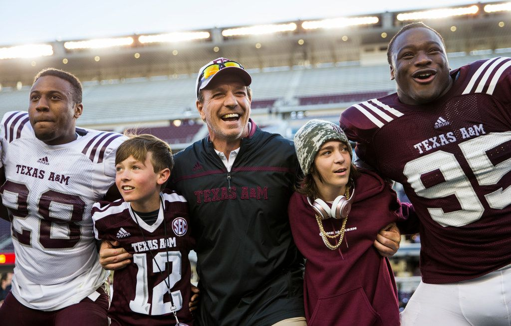 FILE - Texas A&M head coach Jimbo Fisher, center, sings the school song with his team after the Maroon and White spring game on Saturday, April 14, 2018 at Kyle Field in College Station. (Ashley Landis/The Dallas Morning News)