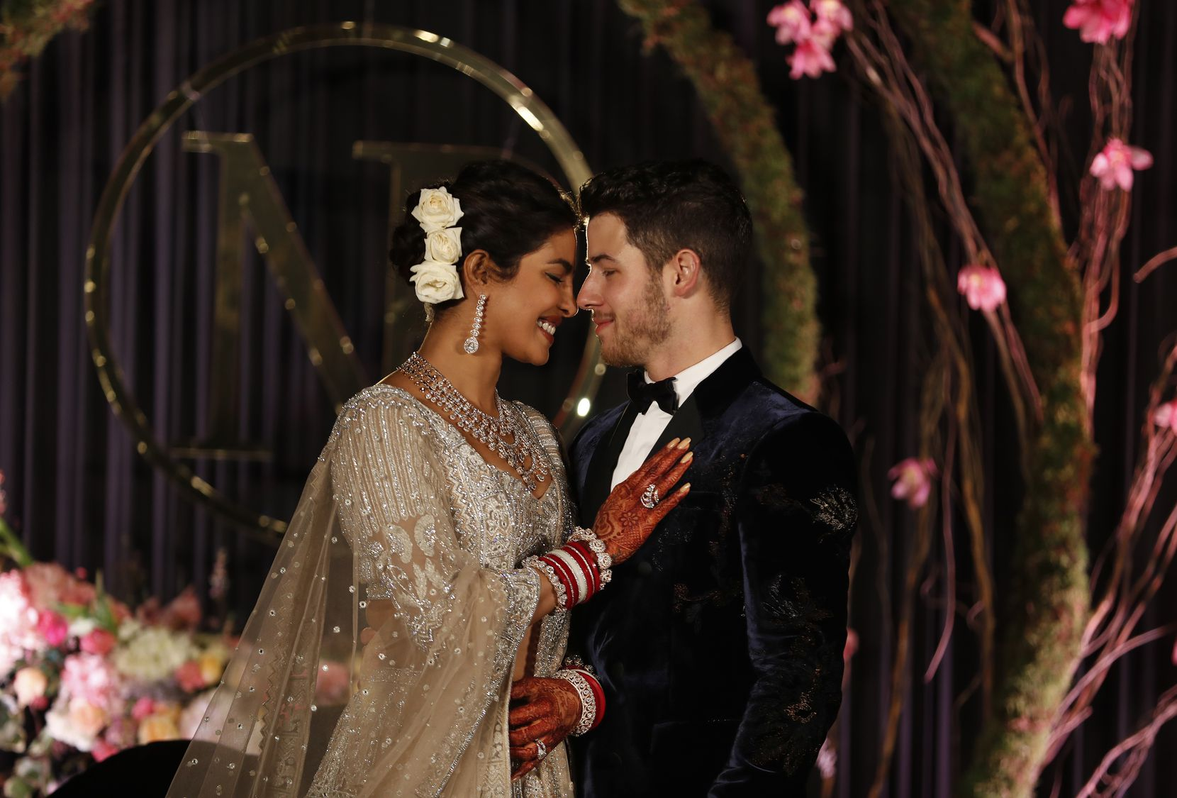 Bollywood actress Priyanka Chopra and musician Nick Jonas stand for photographs at their wedding reception in New Delhi, India, Tuesday, Dec. 4, 2018.