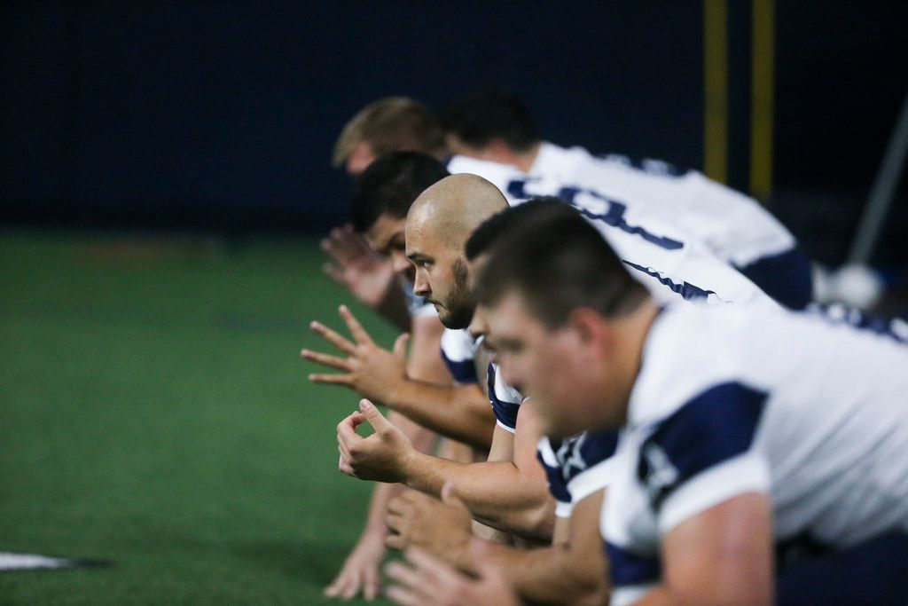 Dallas Cowboys tackle Brandon Knight (center) runs through drills with his other offensive linemen during the Cowboys rookie minicamp practices at The Star in Frisco, Texas on Friday, May 10, 2019.(Shaban Athuman/Staff Photographer)