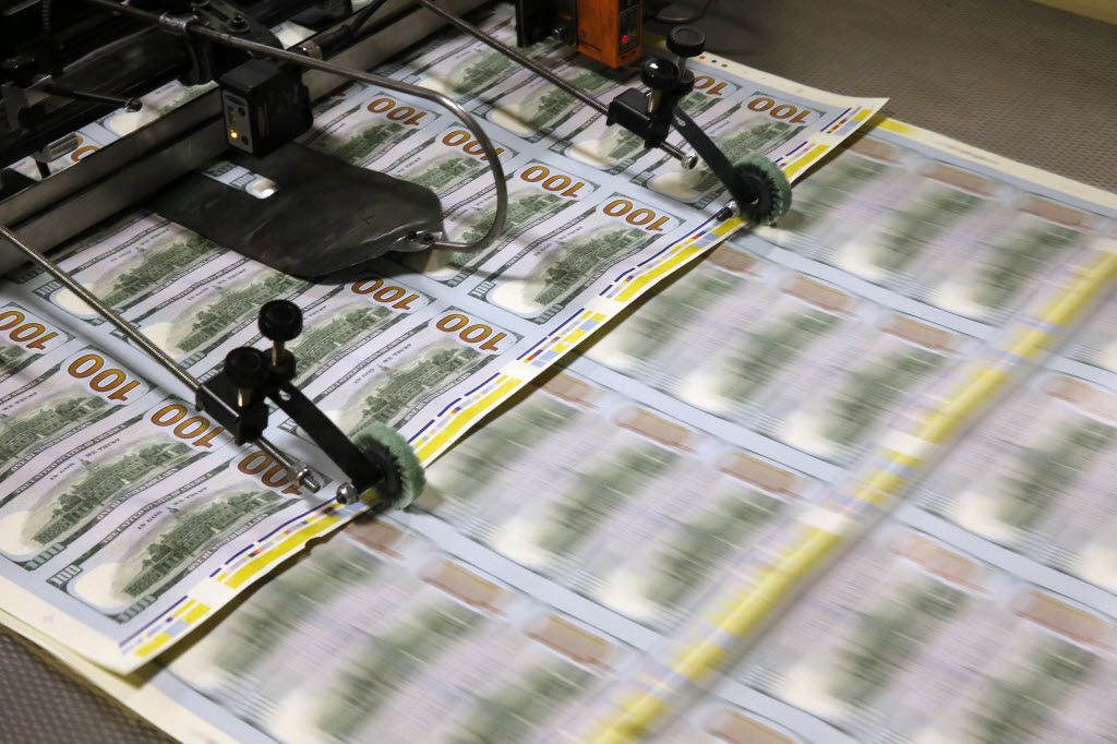 $100 notes feed through the printer at the Bureau of Engraving and Printing in Fort Worth on Wednesday, April 20, 2016. (Vernon Bryant/The Dallas Morning News)