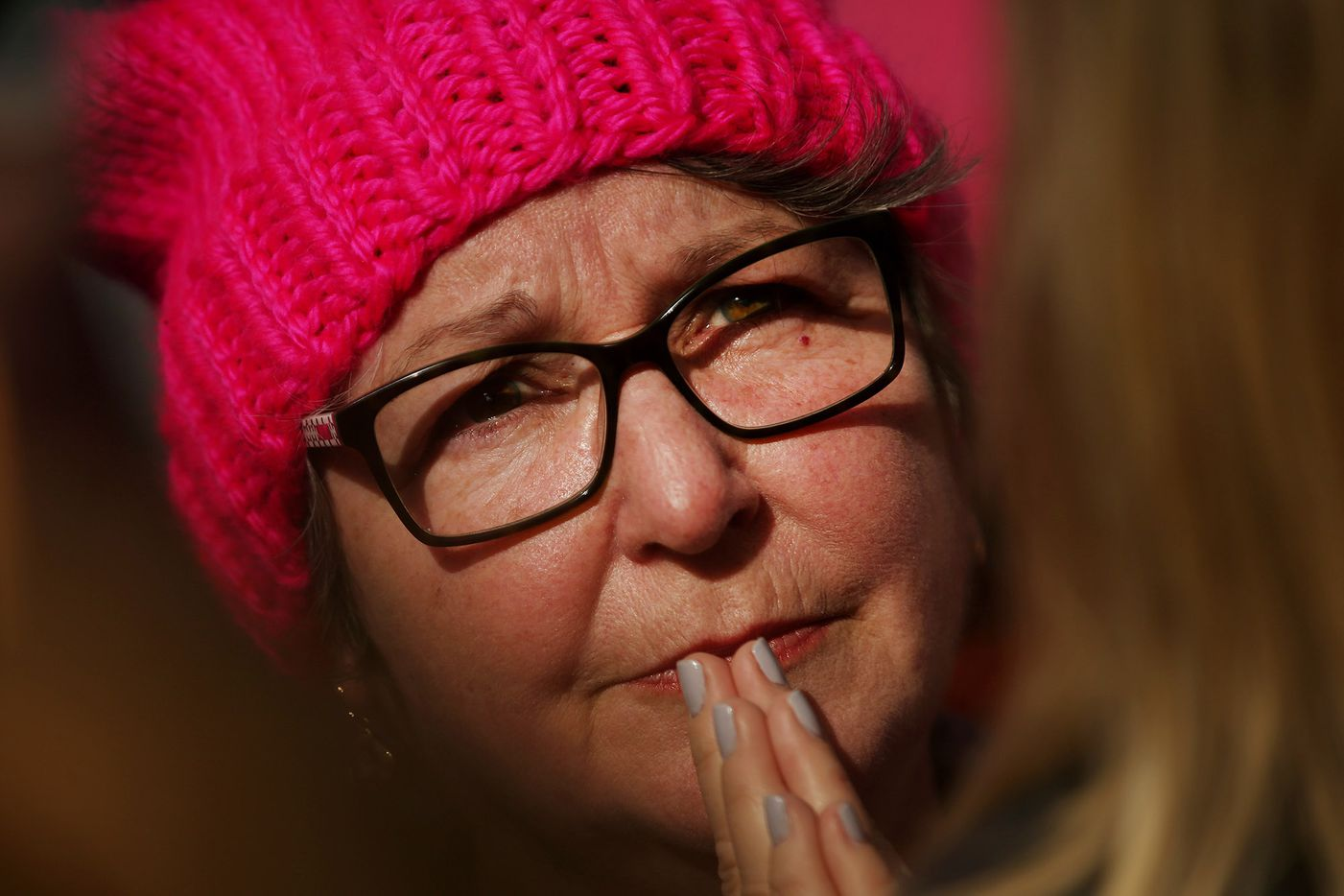 A marchers listens as Rabbi Nancy Kasten speaks at Pike Park during the rally portion of the Dallas Women's March in Dallas Saturday January 20, 2018.