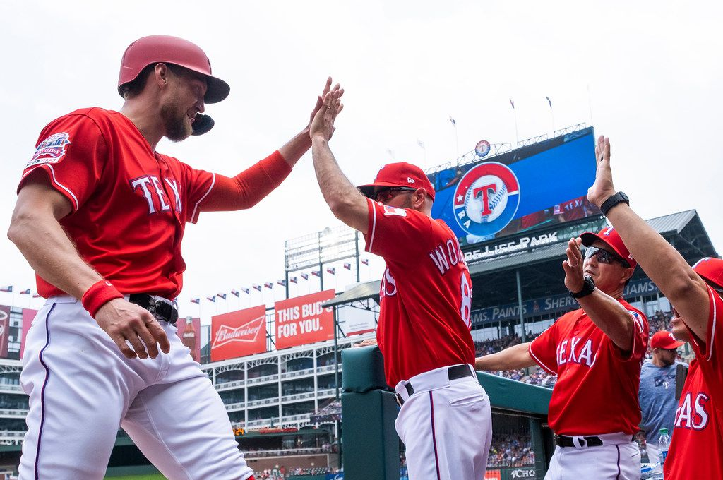Texas Rangers designated hitter Hunter Pence (24) celebrates with manager Chris Woodward after scoring a run during the first inning against the Seattle Mariners at Globe Life Park on Wednesday, May 22, 2019, in Arlington. (Smiley N. Pool/The Dallas Morning News)