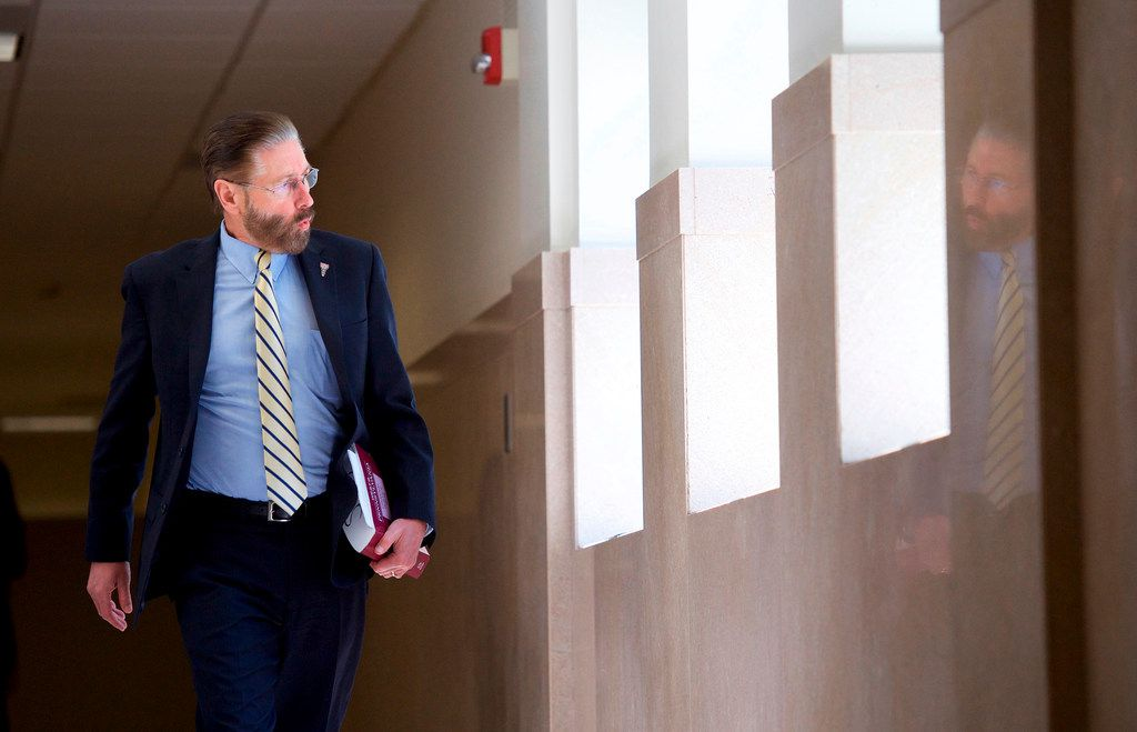 Judge Steven T. O'Neill whistles as he walks through the courthouse after learning a verdict was in for the Bill Cosby's sexual assault retrial.