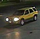 The robbers fled in a yellow Ford Escape. (Dallas Police Department)