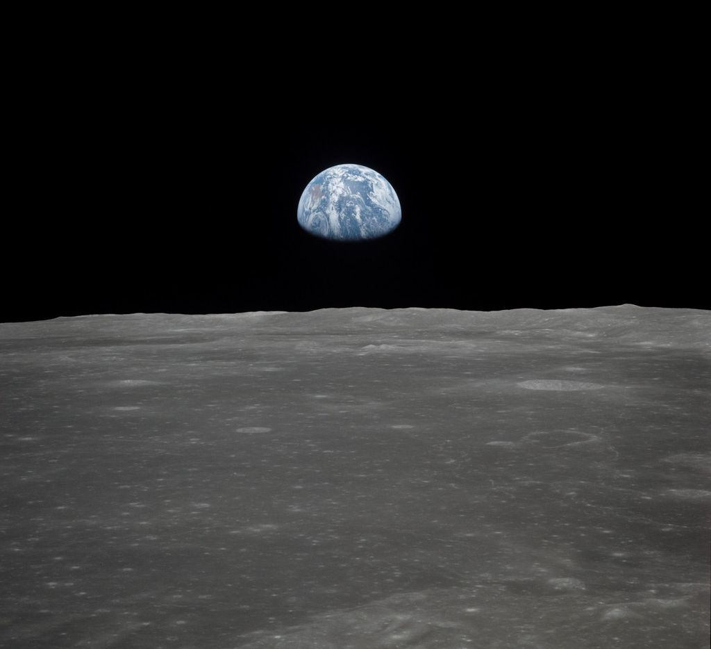 This July 1969 NASA file photo obtained July 16, 2019 shows a file view of Earth rising over the Moon's horizon taken from the Apollo 11 spacecraft.
