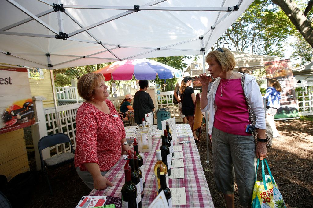 Sue Verrill of Caudalie Crest Winery gives a wine sample to Lynda Teasley at the McKinney Farmer's Market in historic Chestnut Square in McKinney.