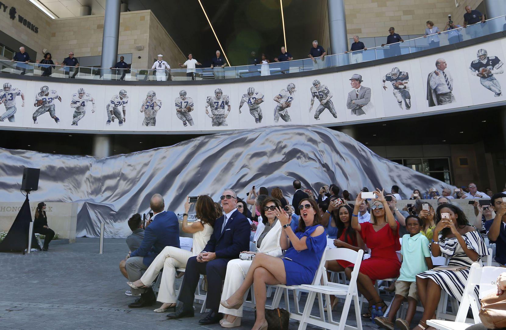 Dallas Cowboys Ring of Honor members unveil one side of the ring during the Ring of Honor Walk unveiling ceremony at The Star in Frisco on Aug. 21.