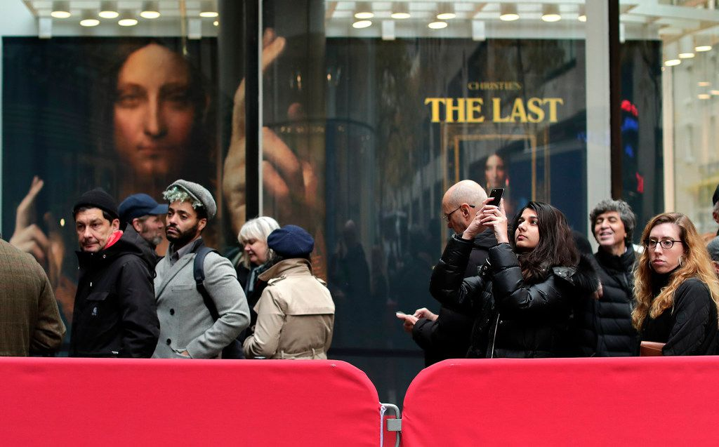 """Visitors to Christie's wait outside in a line to view Leonardo da Vinci's """"Salvator Mundi"""", Tuesday, Nov. 14, 2017, in New York. The painting is expected to sell at auction for $100 million on Wednesday. (AP Photo/Julie Jacobson)"""