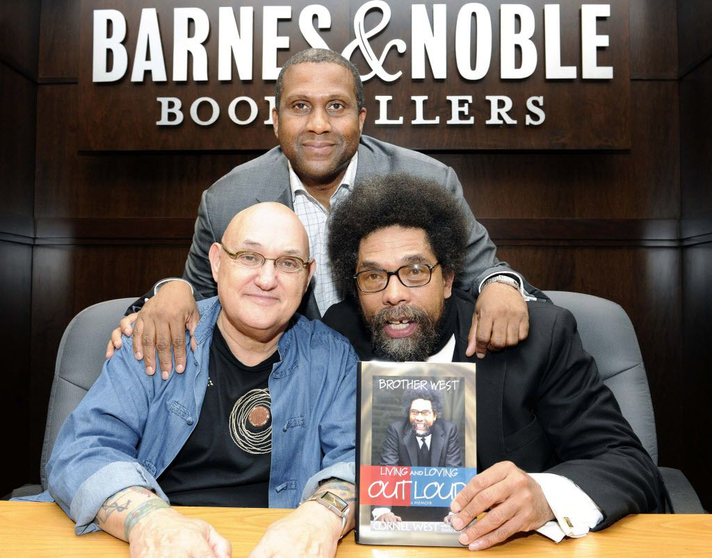 """Biographer David Ritz, left, Tavis Smiley, top, and Dr. Cornel West are in attendance at the """"BROTHER WEST: Living and Loving Out Loud"""" book signing, Wednesday, Oct. 7, 2009, in Los Angeles. (AP Photo/Earl Gibson III) ORG XMIT: CAEG101"""