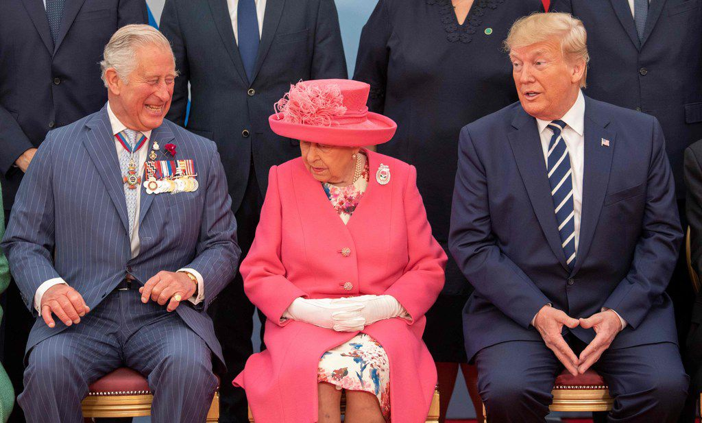 Britain's Prince Charles, Prince of Wales (L), Britain's Queen Elizabeth II and US President Donald Trump pose for the official family photograph during an event to commemorate the 75th anniversary of the D-Day landings, in Portsmouth, southern England, on June 5, 2019. - US President Donald Trump, Queen Elizabeth II and 300 veterans are to gather on the south coast of England on Wednesday for a poignant ceremony marking the 75th anniversary of D-Day.