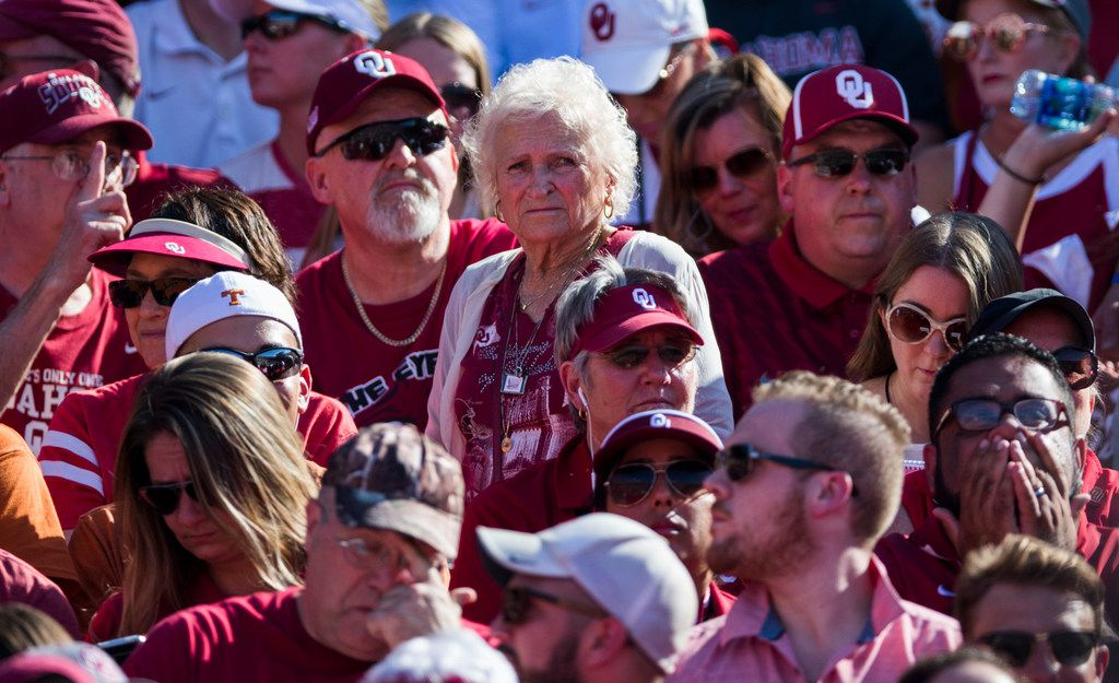 Oklahoma Sooners fan Nancy McCall, 83, watches from the stands during the AT&T Red River Showdown college football game between the University of Texas and Oklahoma University on Oct. 14 at the Cotton Bowl in Fair Park in Dallas.