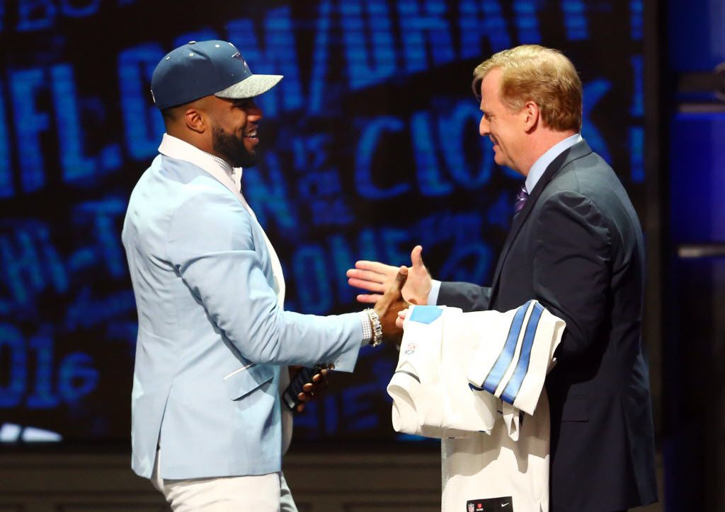 Apr 28, 2016; Chicago, IL, USA; Ezekiel Elliott (Ohio State)with NFL commissioner Roger Goodell selected by the Dallas Cowboys as the number four overall pick in the first round of the 2016 NFL Draft at Auditorium Theatre. Mandatory Credit: Jerry Lai-USA TODAY Sports