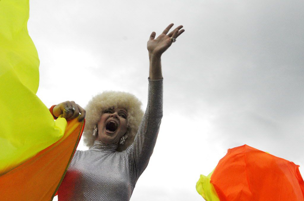 Rodd Gray, a.k.a. Patti Le Plae Safe, waves to the crowd during the Texas Freedom Parade and rally in Dallas on a rainy Sept. 17, 2006.
