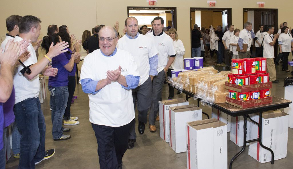 Volunteers rush into the Gaylord Texan's conference center to help break the Guinness World Record for the highest number of PB&J sandwiches made in one room in one hour.