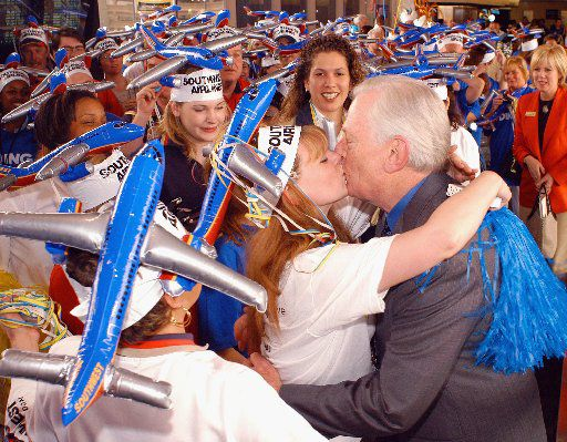 Southwest Airlines Chairman Herb Kelleher greets employees at a parade during a welcoming ceremony at Philadelphia International Airport on May 10, 2004 in Philadelphia, Pa. Southwest Airlines inaugurated the start of service at Philadelphia International Airport with 14 flights daily.