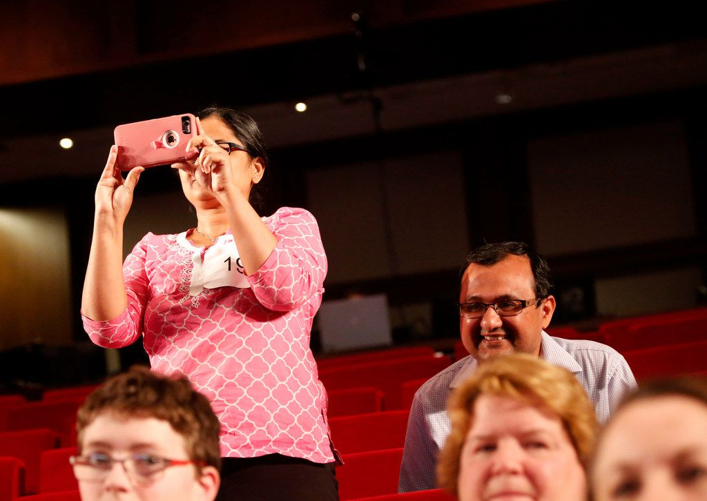 Naysa's parents, Vaishali (left) and Nayan Modi, watch as their daughter is named co-champion of the Golden Chick Dallas Regional Spelling Bee. (Rose Baca/The Dallas Morning News)