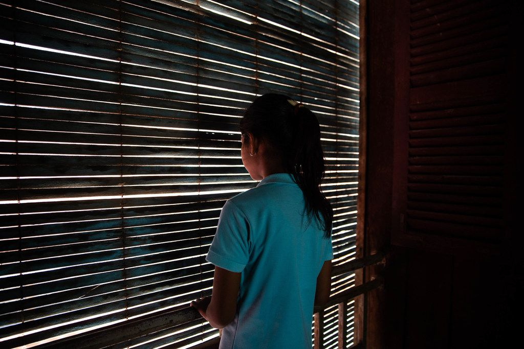 Soryia, a 14-year-old rape victim, stood by a dormitory window at the Cambodian Women's Crisis Center shelter in Phnom Penh, Cambodia, in July. She has lived at the shelter for almost a year. As Cambodia struggles with high rates of gender violence, activists and organizations aim to provide sexual health training for young women, empowering them through education and factory jobs for those at risk of sex trafficking. Villagers at Svay Pak district, an ethnically Vietnamese center infamous for child prostitution at the outskirts of Phnom Penh, have seen a significant drop in sex trafficking since the organizations started providing education for those at risk of turning to prostitution for money.