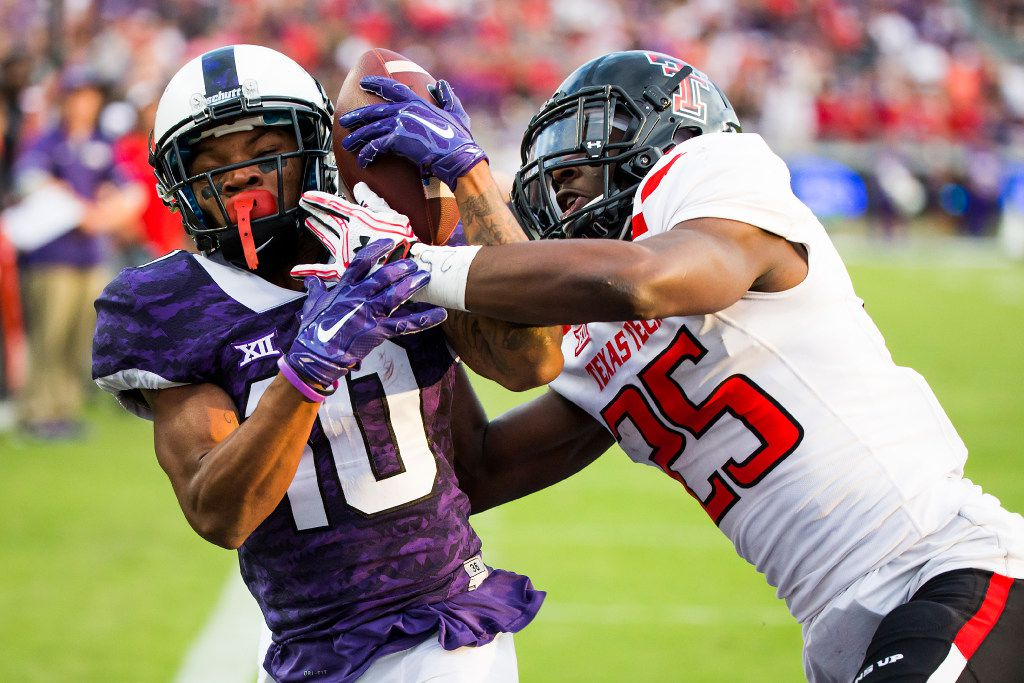 TCU wide receiver Desmon White (10) catches a 25-yard touchdown pass as Texas Tech defensive back Douglas Coleman (25) defends during the first overtime in an NCAA football game at Amon G. Carter Stadium on Saturday, Oct. 29, 2016, in Fort Worth. (Smiley N. Pool/The Dallas Morning News)