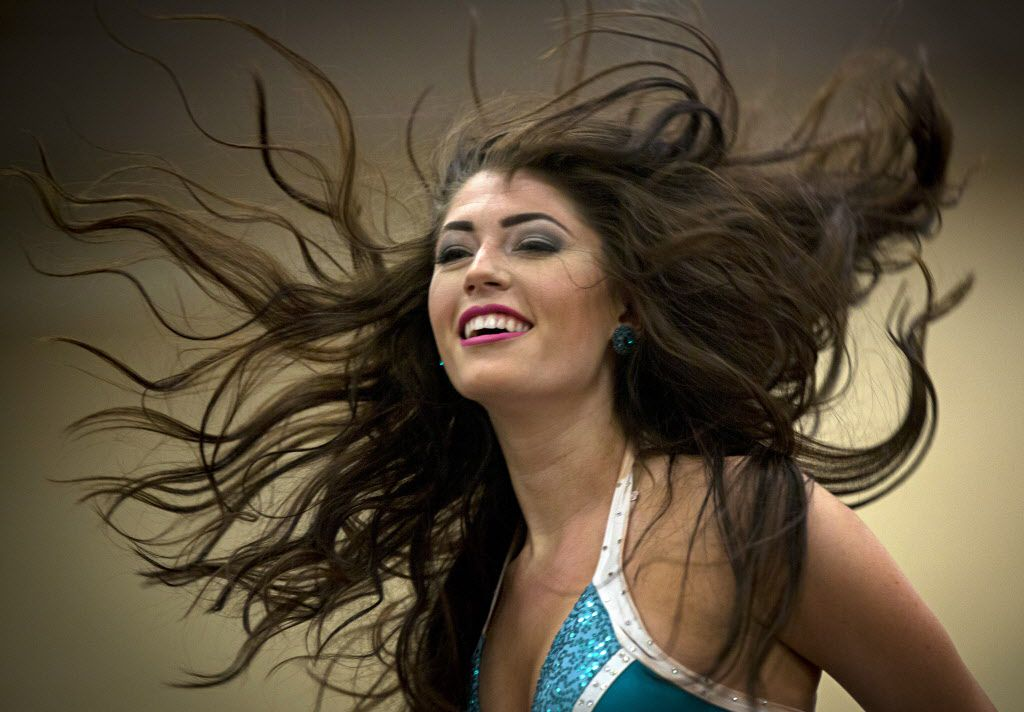 Victoria Jameson of Keller, Texas, flips her hair as she performs for judges during final auditions to join the 2015-2016 Dallas Mavericks Dancers team Sunday, July 12, 2015 in Dallas. More than 40 women made it to the finals, vying for a spot to take part in a training camp later in the week.