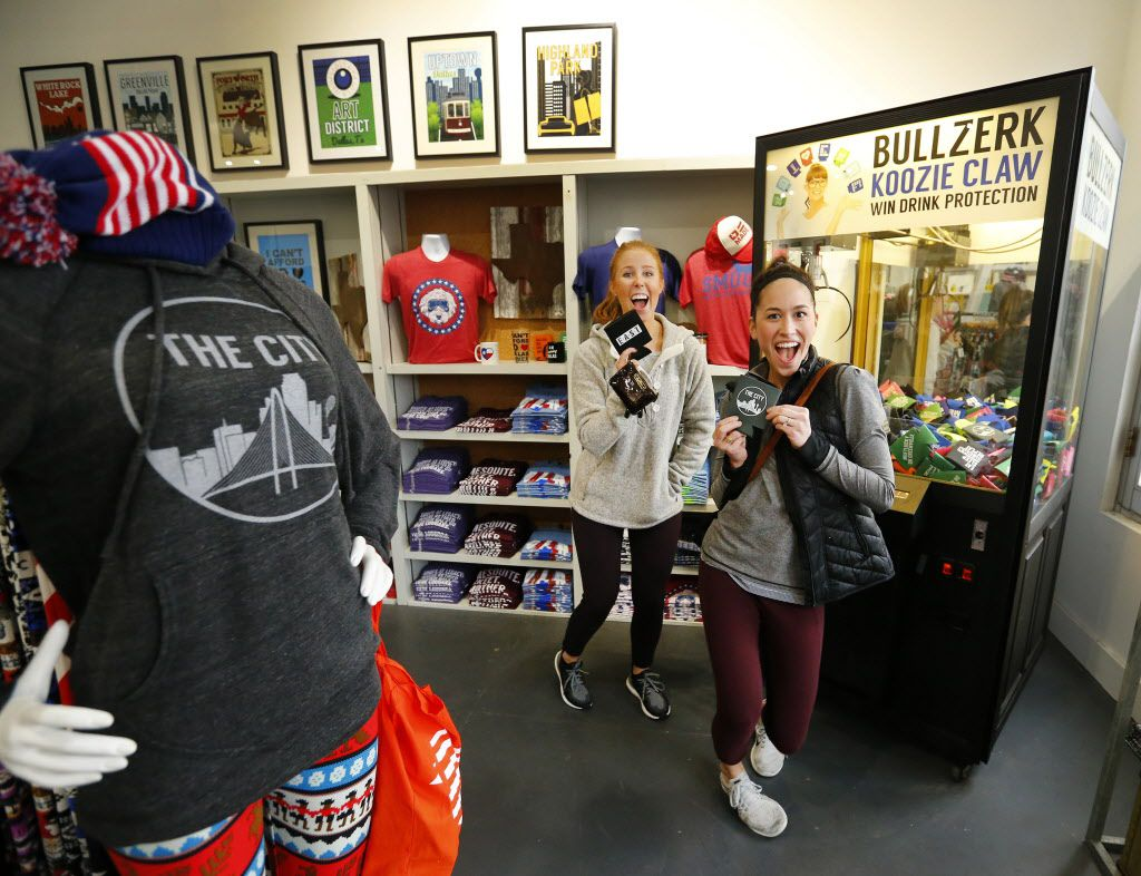 Dallas friends Emiley (cq) Walker (left) and Sarah Kendrick show off the koozies they grabbed using a claw in a vending machine in Bullzerk, a store on Lower Greenville Ave.