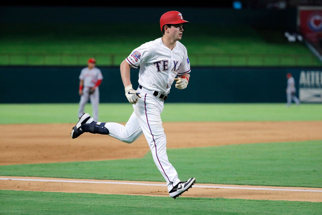 Texas Rangers' Nick Solak runs the bases after hitting solo home run on a pitch from Los Angeles Angels starter Jaime Barria, rear, in the fifth inning of a baseball game in Arlington, Texas, Tuesday, Aug. 20, 2019. The shot was Solak's first of his major league career. (AP Photo/Tony Gutierrez)
