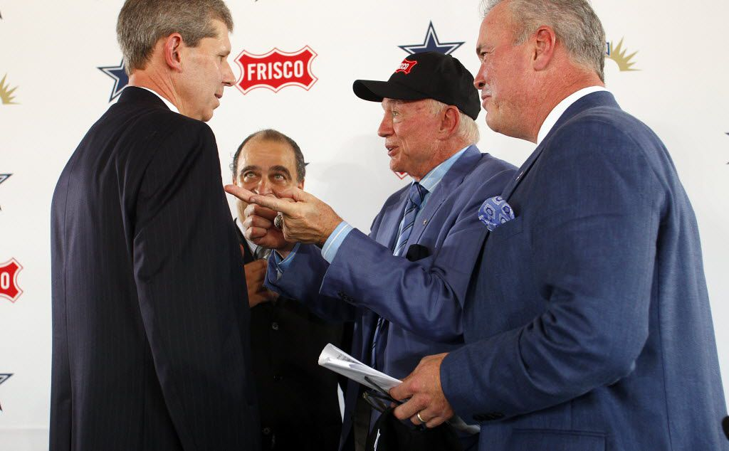 Frisco, Texas, mayor Maher Maso, (second from left, background) watches as Dallas Cowboys owner/general manager Jerry Jones, second from right, and Executive Vice President, Chief Operating Officer Stephen Jones, right, visit with Frisco Independent School District (FISD) Superintendent Dr. Jeremy Lyon, left, after announcing a multi-use special events and sports facility, to be developed on a footprint of approximately 20 acres, and the Cowboys world corporate headquarters on approximately 5 acres, which will be the centerpiece of additional mixed-use development on property surrounding the teamÕs new location at Warren Parkway and the North Dallas Tollway, Tuesday, August 13, 2013. (Tom Fox/The Dallas Morning News)
