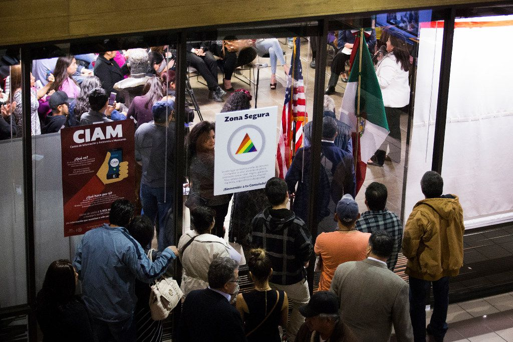 An overflow crowd spills out into the next toom during a community meeting on possible deportations at the Consulate General of Mexico on Thursday, Feb. 16, 2017, in Dallas. (Smiley N. Pool/The Dallas Morning News)