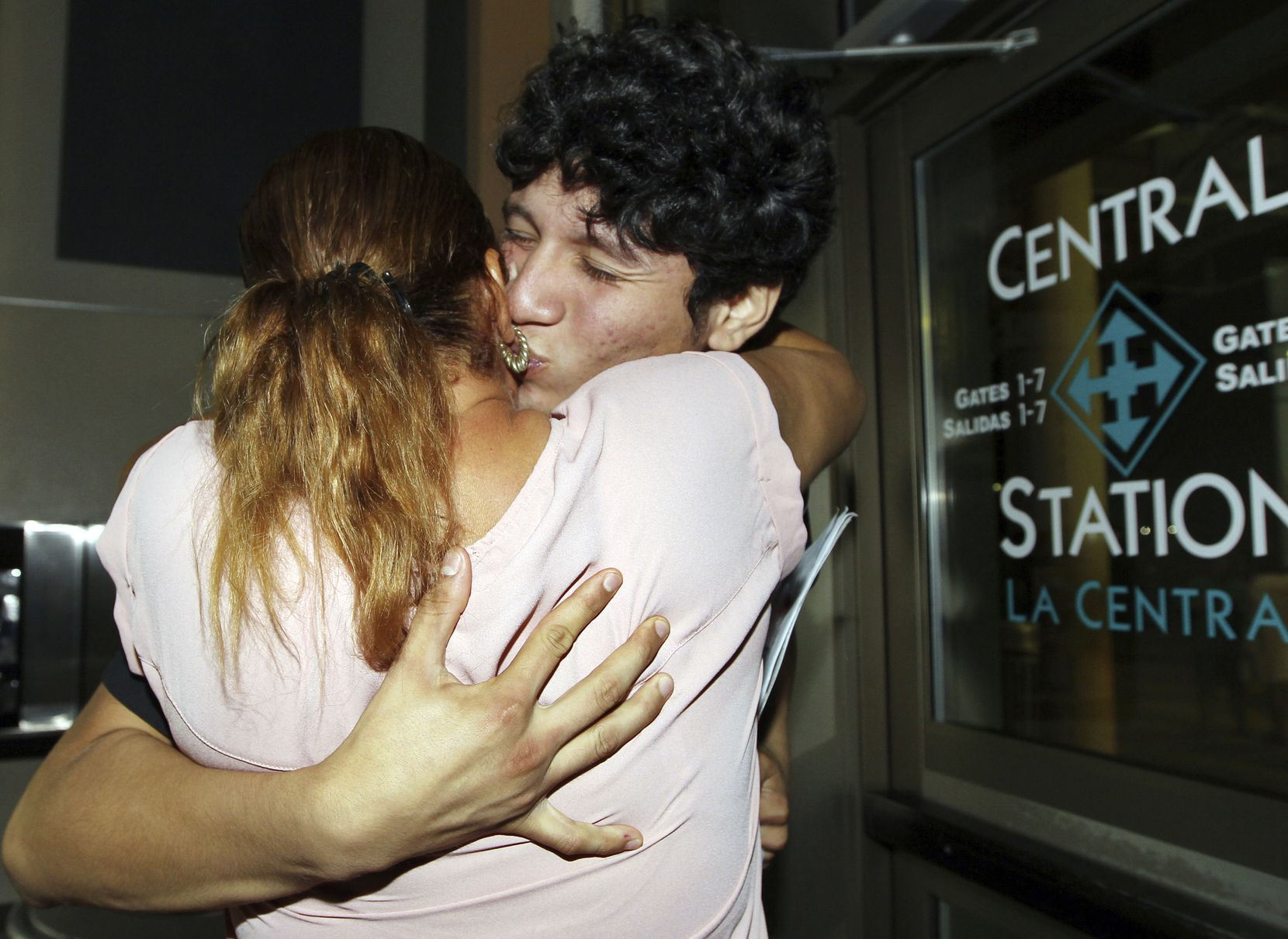 Francisco Galicia, right, kisses his mother Sanjuana Galicia at the McAllen, Texas, Central Station, Wednesday, July 24, 2019. Galicia, 18, who was born in the U.S. was released Tuesday, July 23, from federal immigration custody after wrongfully being detained for more than three weeks.