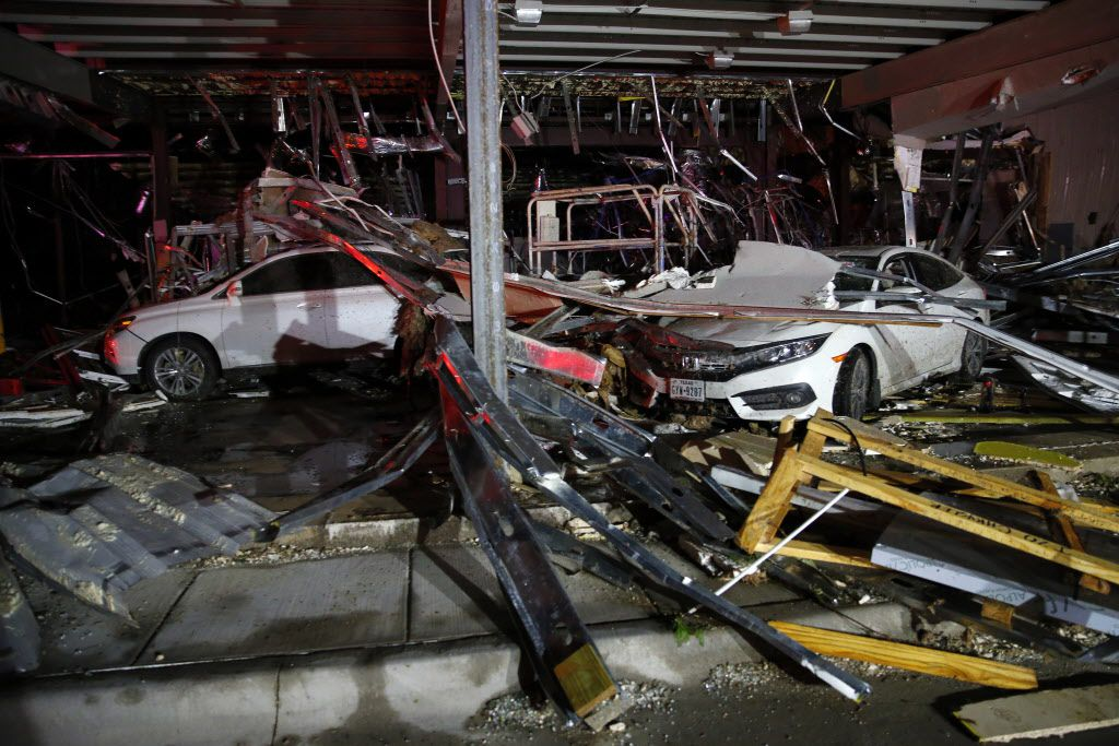 Cars and trucks are damaged as the walls blew out of the I-20 Dodge dealership after a tornado hit near Canton, Texas, Saturday, April 29, 2017.