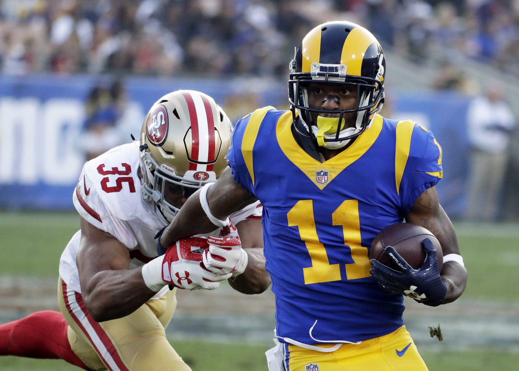 FILE - Tavon Austin (11) runs with the ball during the first half of a game against the San Francisco 49ers on Sunday, Dec. 31, 2017, in Los Angeles. (AP Photo/Rick Scuteri)