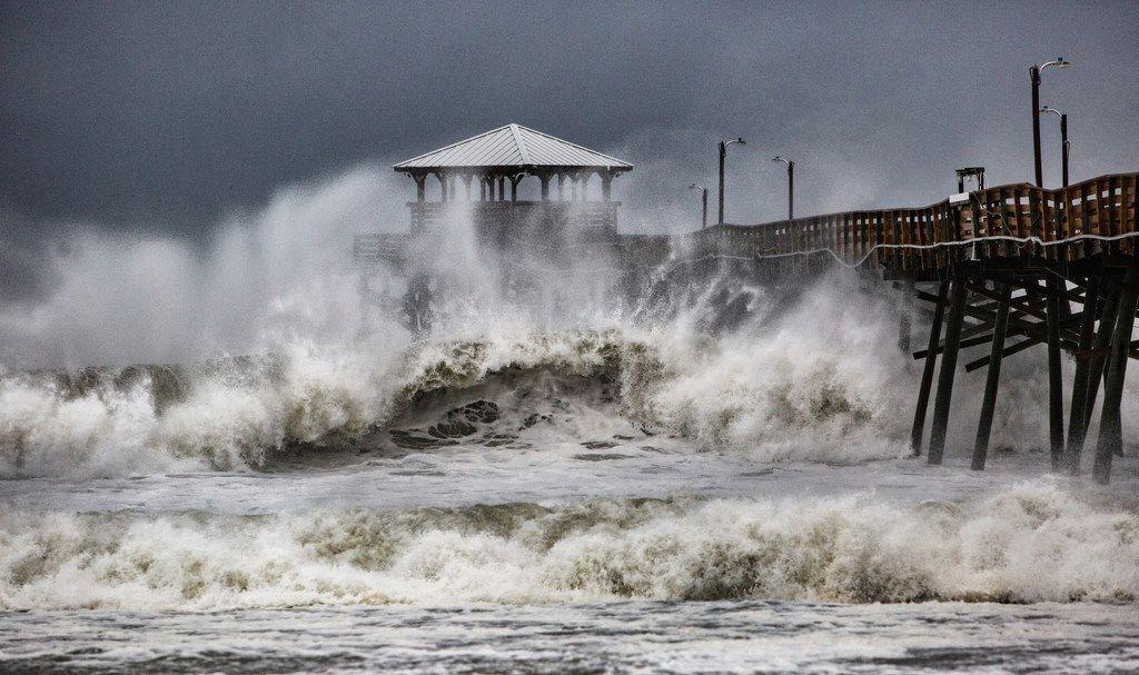 Waves slam the Oceana Pier & Pier House Restaurant in Atlantic Beach, N.C., on Thursday as Hurricane Florence approaches the area.