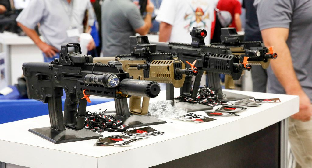 Semi-automatic long guns were on display at a booth at the NRA Personal Protection Expo, held this weekend in Fort Worth.
