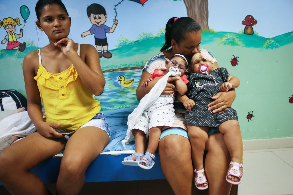 RECIFE, BRAZIL - JUNE 02:  Babies with microcephalia are held by a mother as she allows another mother to rest at a rehabilitation clinic on June 2, 2016 in Recife, Brazil. Microcephaly is a birth defect linked to the Zika virus where infants are born with abnormally small heads. The Brazilian city of Recife and surrounding Pernambuco state remain the epicenter of the Zika virus outbreak, which has now spread to many countries in the Americas. A group of health experts recently called for the Rio 2016 Olympic Games to be postponed or cancelled due to the Zika threat but the WHO (World Health Organization) rejected the proposal.  (Photo by Mario Tama/Getty Images)