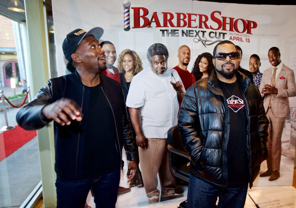 """Actors Lamorne Morris, left, and O'Shea Jackson, known by his stage name Ice Cube, walk the red carpet for a screening of """"Barbershop, The Next Cut"""" at the Angelika Monday, March 21, 2016. (Brandon Wade/Special Contributor)"""