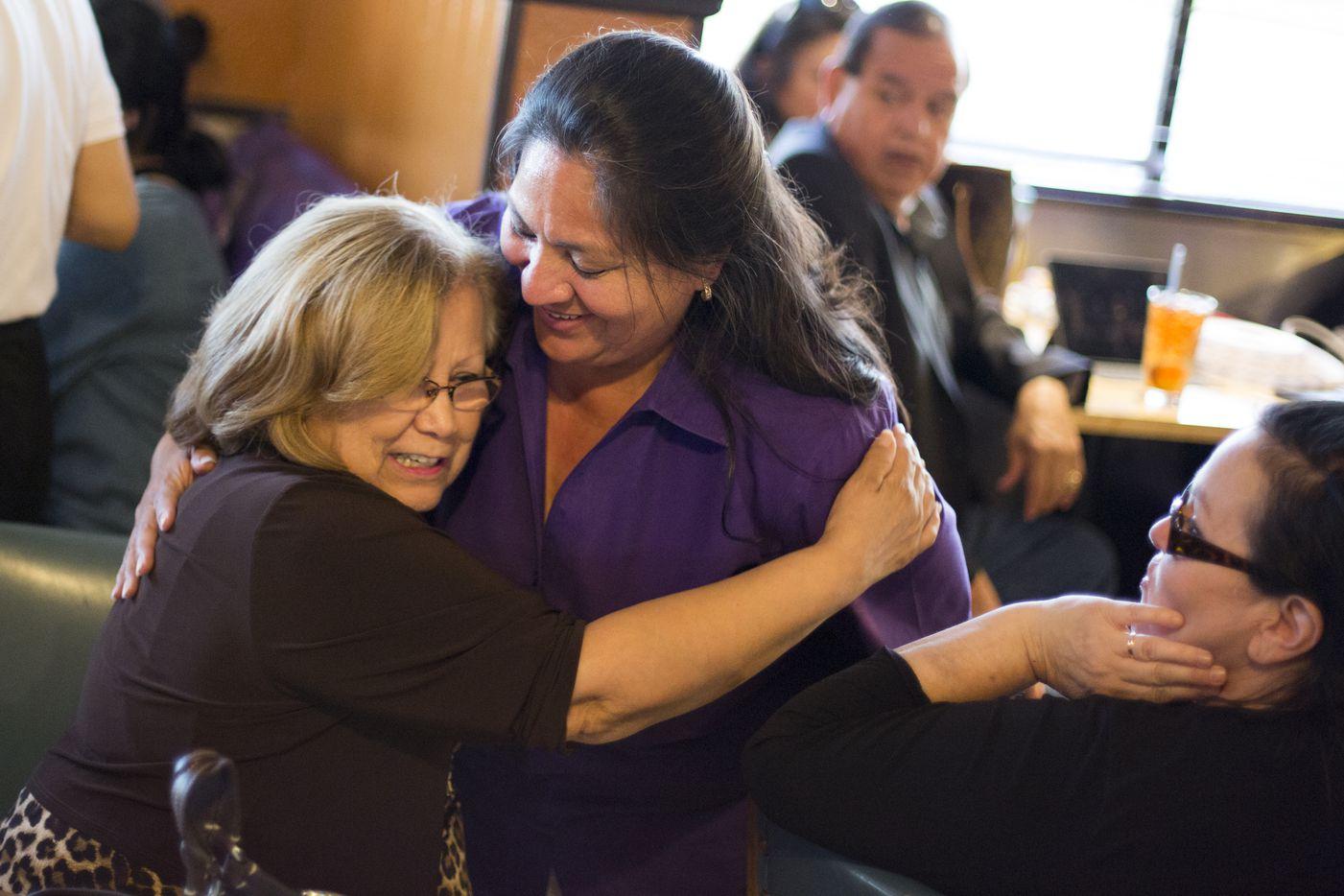 Julia Suarez-Macias (left) hugs Monica Alonzo, Dallas City Councilwoman representing District 6, during an election night party May 6, 2017, at Buena Vista Restaurant in Dallas, Texas.