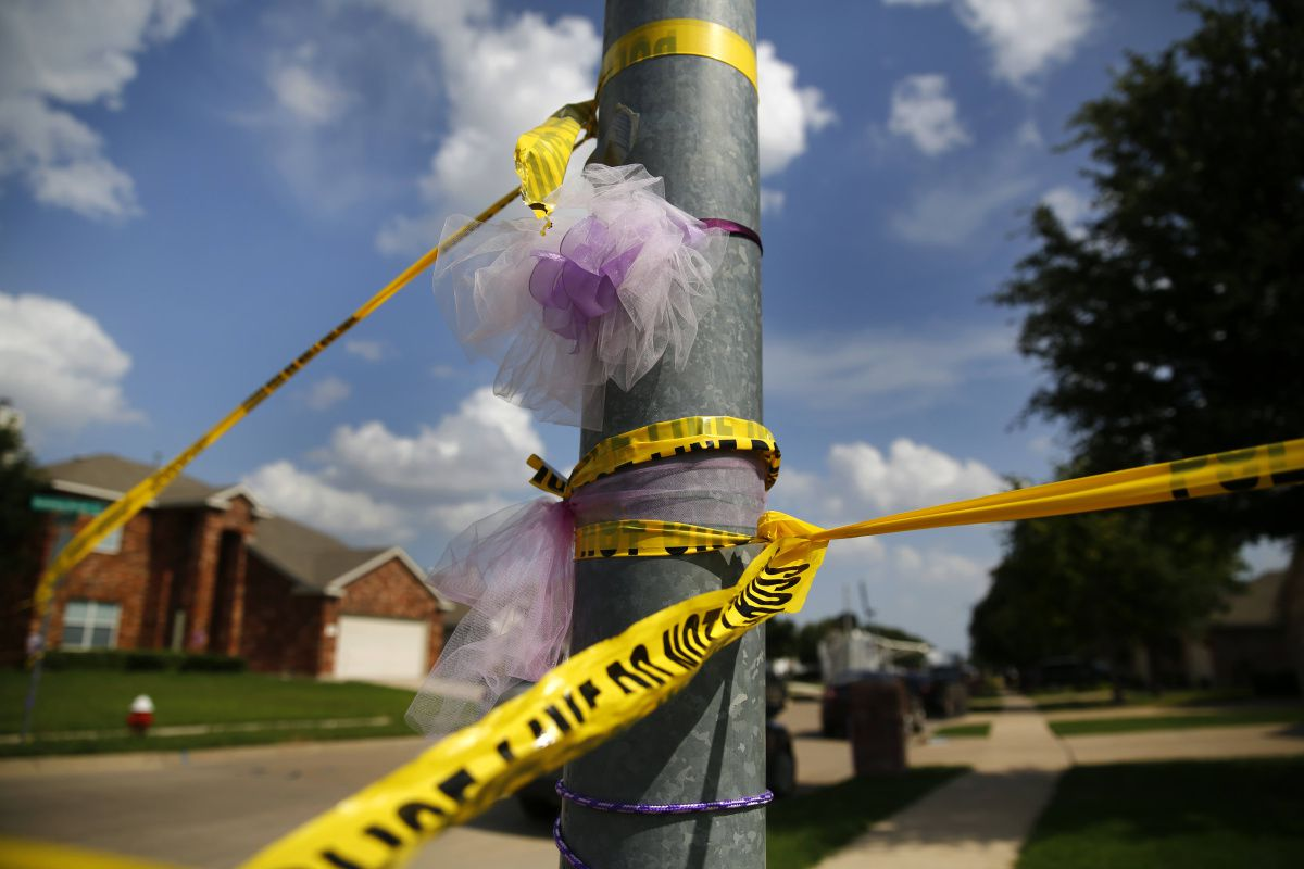 A light pole that was wrapped in purple ribbons for slain 6-year-old Alanna Gallagher was also wrapped in police tape Tuesday after the shootout.