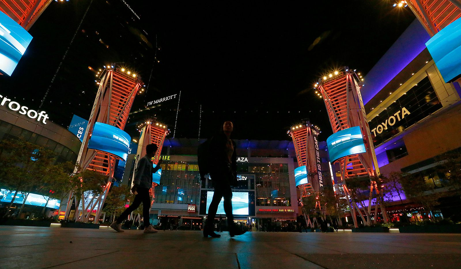 A couple stroll through L.A. Live in downtown Los Angeles.