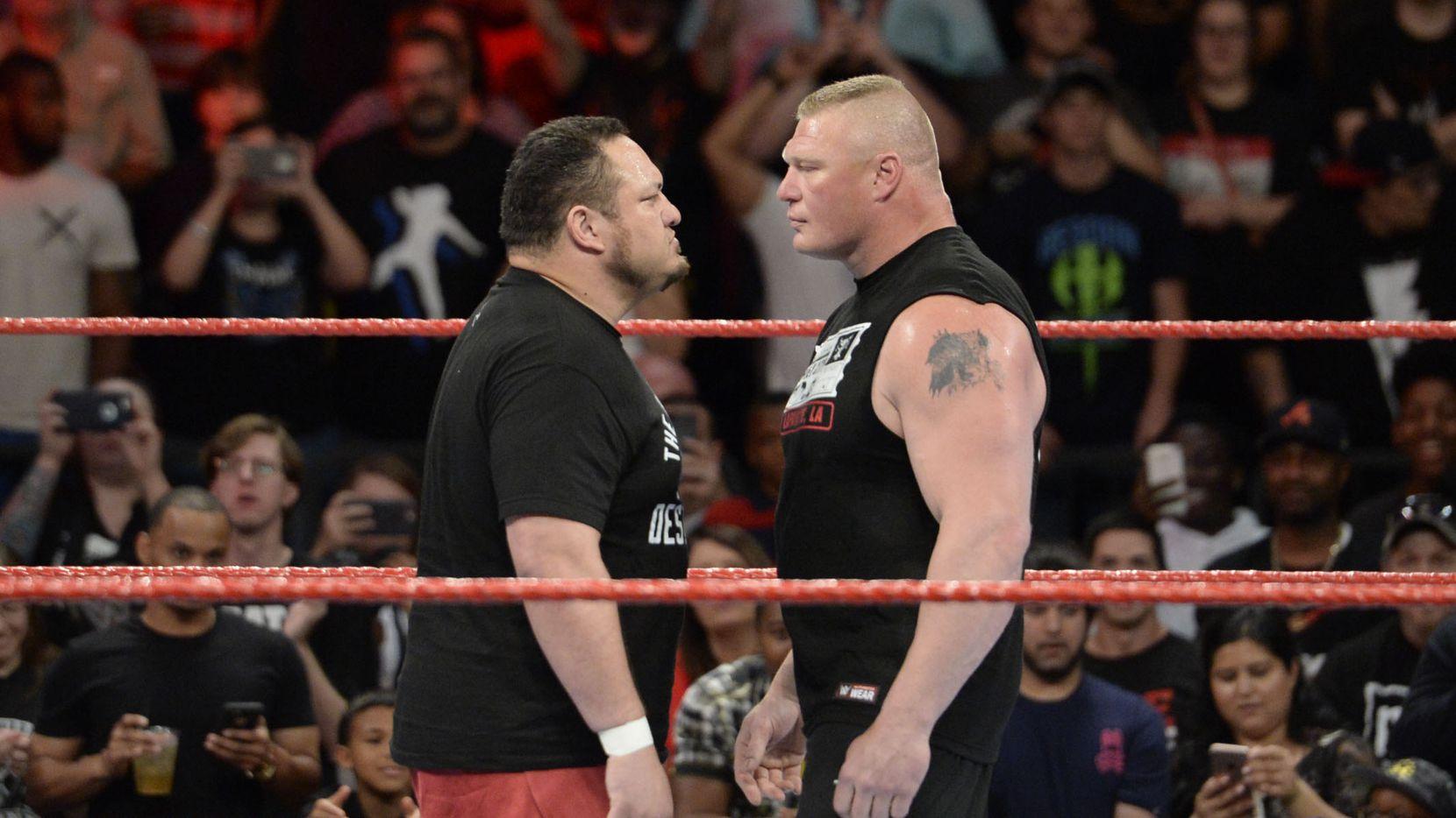 No. 1 contender Samoa Joe (left) stares down WWE universal champion Brock Lesnar (right) on Monday Night Raw.