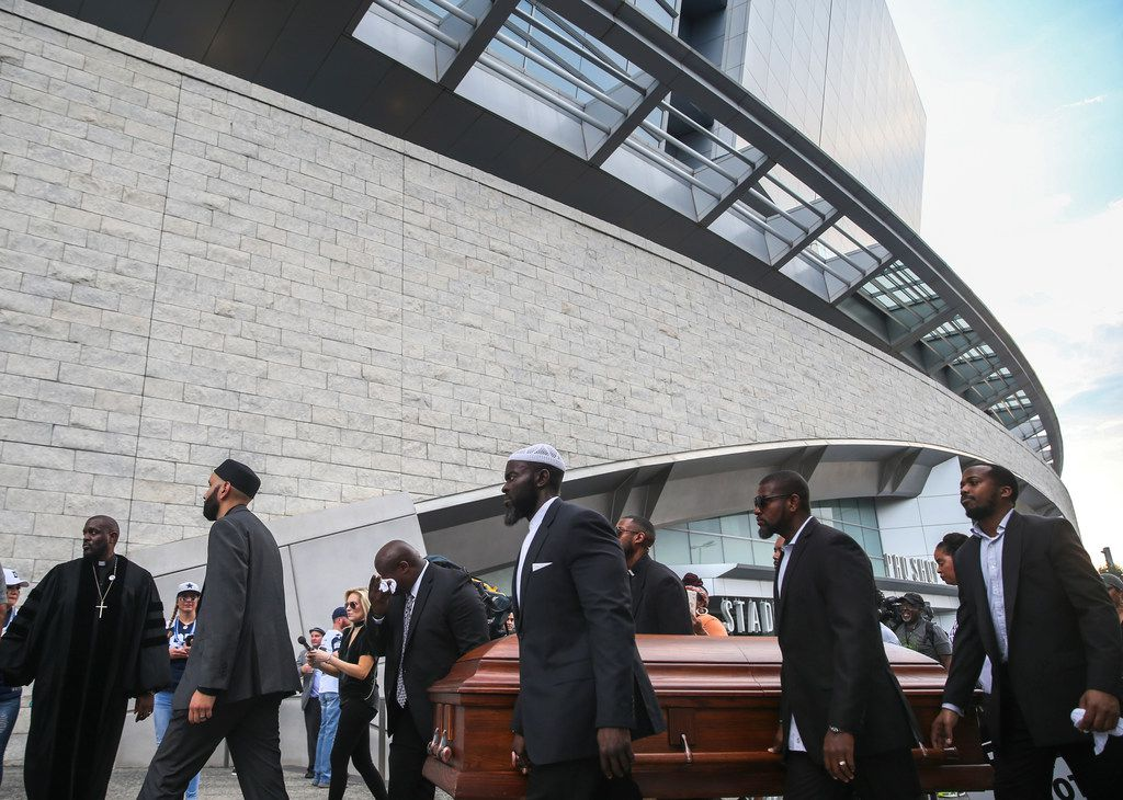 Members of the clergy and community carried empty coffins around AT&T Stadium in Arlington in protest officer slayings.