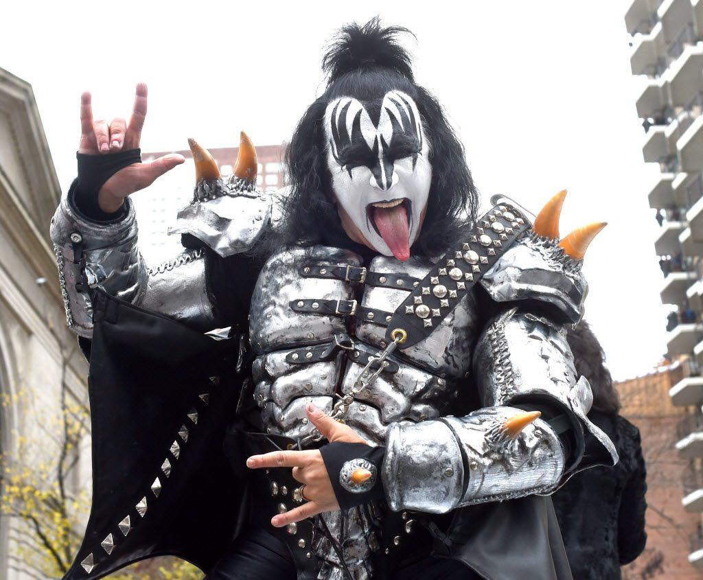Gene Simmons of Kiss sticks his tongue out as the band comes down Central Park West during the 88th Macy's Thanksgiving Day Parade in New York on November 27, 2014. Kiss performed a medley of their hits for an estimated 3.5 million people who lined the parade route.  AFP PHOTO / Timothy A. ClaryTIMOTHY A. CLARY/AFP/Getty Images 01212015xBIZ