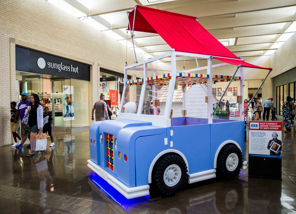A playhouse in the shape of a vehicle is on display as part of the Parade of Playhouses, benefiting Dallas CASA, on July 13, 2019, at NorthPark Center in Dallas. The playhouses are raffled off to raise money for the agency. (Ashley Landis/The Dallas Morning News)